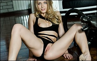 Sharon D in black lingerie and high heels loves teasing
