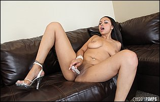 Bethany Benz in sexy heels presents her body and playing with a dildo