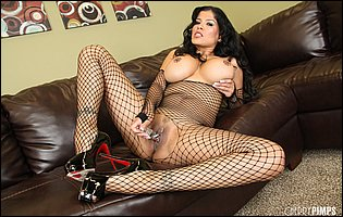 Alexis Amore in black body fishnet and sexy high heels likes teasing
