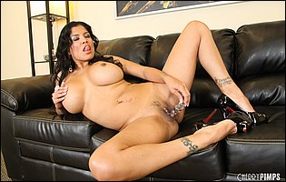 Alexis Amore in black high heels sticks a glass dildo in her tight cunt