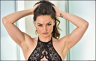 Tori Black in sexy black underwear and high heels teasing with tight body