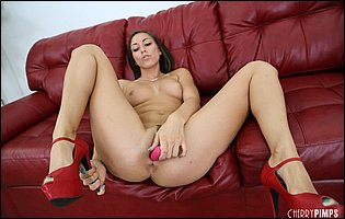 Rilynn Rae in red high heels pleasuring her pussy with her favorite sex toy