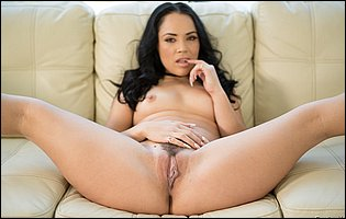 Beautiful brunette Kristina Rose getting nude and spreading her legs on couch