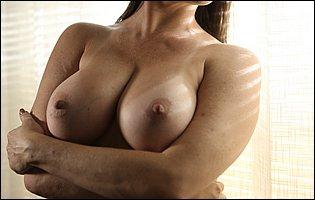 Hot brunette MILF Dana DeArmond teasing with big boobs