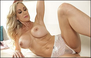 Brandi Love strips her sexy dress and underwear and presents fit body