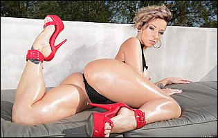 Jada Stevens in sexy red high heels presents her hot body outdoor