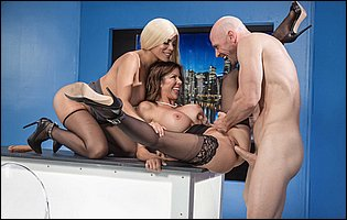 Lusty sluts Alexis Fawx and Luna Star sucking and fucking a big hard dick in the studio