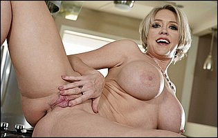Hot mature blonde Dee Williams teasing with hot body in kitchen