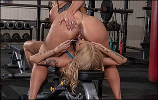 Horny blondes Alura Jenson and Joslyn James have nasty lesbian sex in the gym