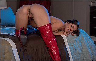 Alexis Fawx in red high latex boots presents her body