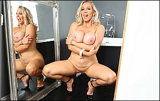 Gorgeous blonde MILF Rebecca More strips and presents her body in the bathroom