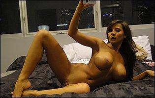 Beautiful brunette Madison Ivy loves posing naked for camera