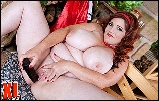 BBW redhead Roxee Robinson teasing with huge boobs and dildoing her cunt