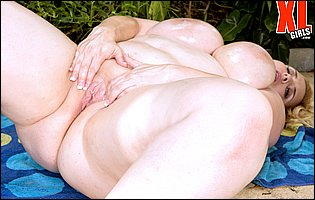 Nikky Wilder exposing oiled body and fingering her pussy outdoor