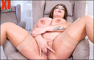 Gorgeous plump brunette Nila Mason posing and fingering her pussy