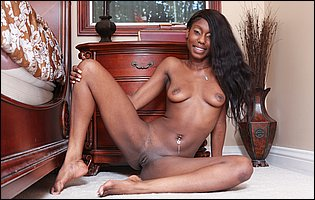 Black beauty Faith Love takes off her sexy bra and panties