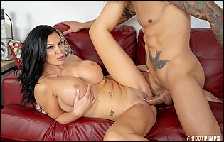 Jasmine Jae getting fucked by tattooed guy on couch