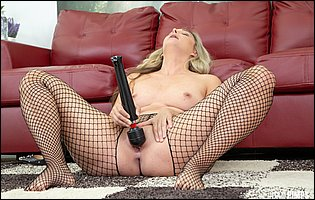 Allie Eve Knox in fishnet pantyhose posing and playing with her favorite sex toyt