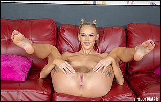 Cute babe Emma Hix getting nude and spreading legs on couch