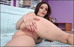 Kimber Woods getting nude and spreading legs in bedroom