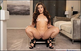 Kimber Woods in sexy shoes presents hot body in living room