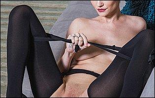 Skye Blue in black lingerie, stockings and heels loves posing for camera