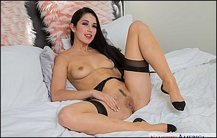 Alex Coal in sexy stockings and black high heels posing for your pleasure in bedroom