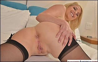 Kit Mercer in black nylons likes teasing with hot body