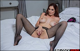 Lilian Stone in sexy black stockings posing and spreading legs in bedroom