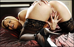 Alexis Texas in black stockings and sexy heels sensually touches herself