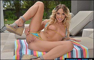 Cute young blonde Khloe Kapri teasing with hot body outdoor