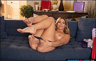 Sexy blonde Leah Lee getting nude in living room
