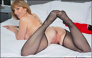 Sara Jay in black nylons loves teasing with hot body in bedroom