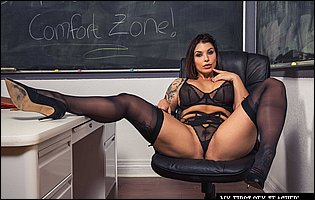 Hot teacher Ivy Lebelle posing in black lingerie, stockings and heels