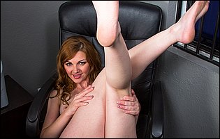 Hot redhead Marie McCray getting naked in the office