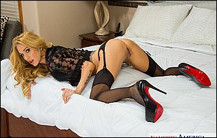 Sarah Jessie in sexy black lingerie, stockings and high heels teasing with athletic body in bedroom