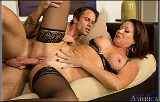 Vanessa Videl in black stockings gets fucked by handsome guy on sofa