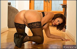 Vanessa Videl posing in sexy underwear, black stockings and high heels