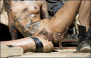 Leigh Raven teasing with tight tattooed body outdoor