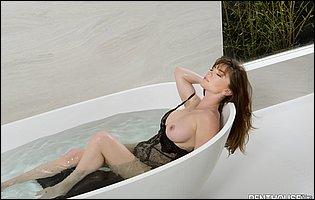 Niki Skyler strips off her sexy black lingerie in the bathroom