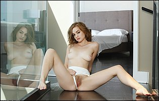 Young beauty Mary Moody getting naked