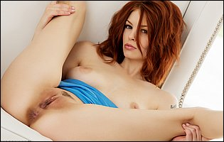 Beautiful redhead Bree Daniels takes off her blue dress