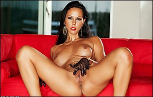 Gorgeous brunette Laly Vallade in white high heels teasing with tight body