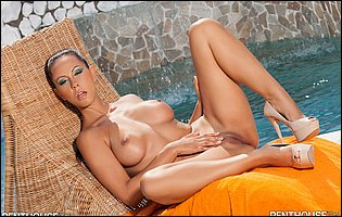 Laly Vallade in high heels teasing with hot body by the pool