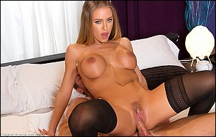Nicole Aniston in black stockings gets banged by handsome guy and takes cum on her boobs