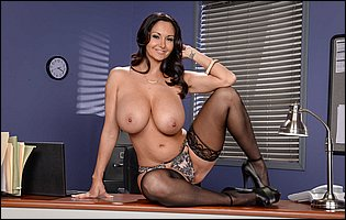 Ava Addams in black nylons and high heels posing on the desk