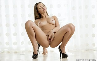 Dani Daniels in sexy lingerie and black high heels loves showing her perfect body