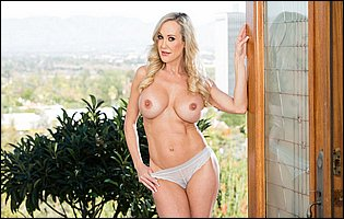 Gorgeous MILF Brandi Love strips off her pink dress and sexy underwear