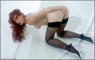 Justine Joli posing in black stockings and high heels