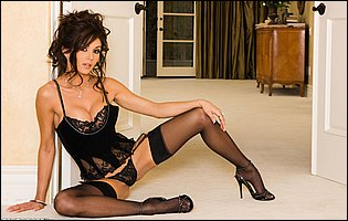 Taya Parker posing in sexy black lingerie, stockings and heels